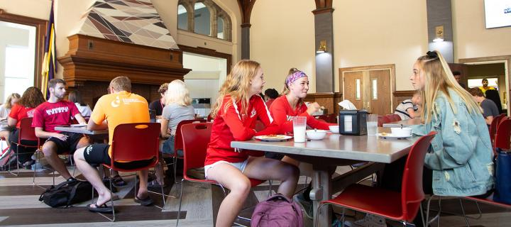 students enjoy a meal in the dining hall