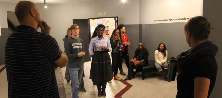 Pato Hebert and students speaking about the piece at the unveiling