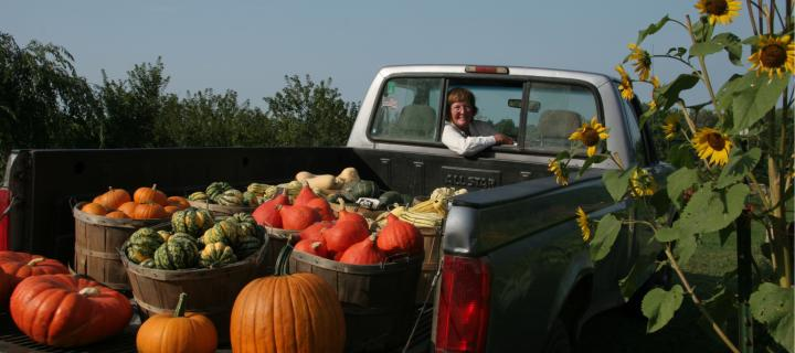 Rosaly Swann Bass with a truck full of vegetables