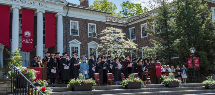 trustees in front of macmillan hall during commencement