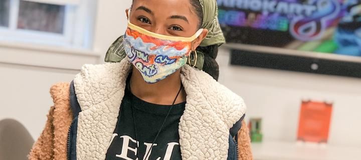 Student with mask in Sommer Center game room