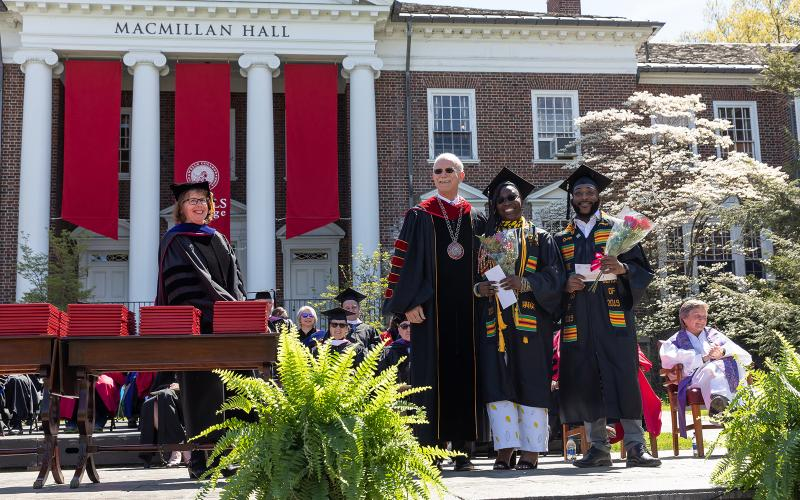 President Gibralter with two graduates