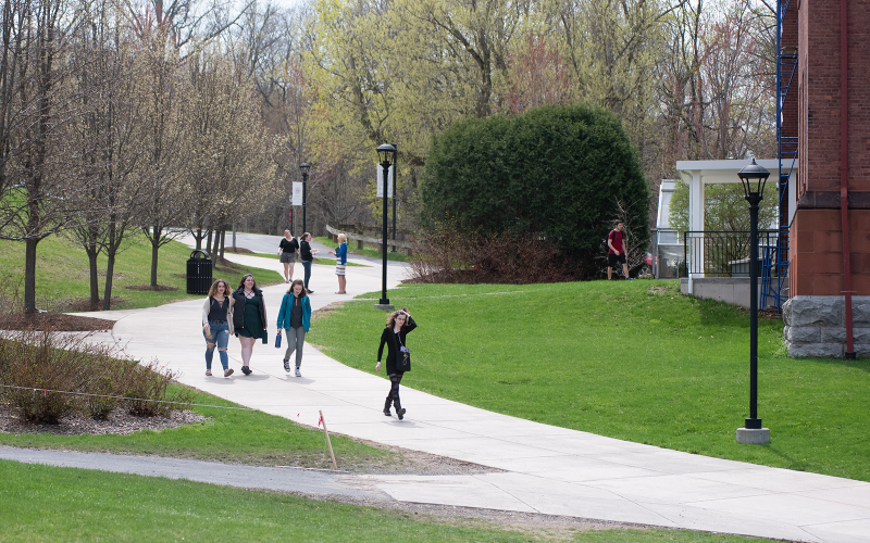 Students walking across campus between Zabriskie and Stratton