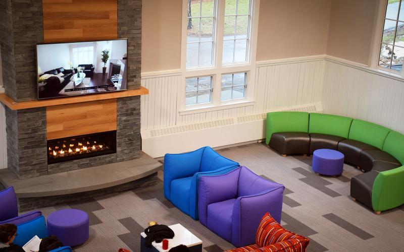 the newly renovated sommer center has a fireplace, comfortable couches, and game room for student use