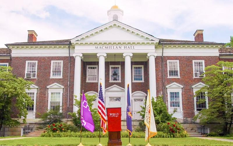 Flags and podium outside the front of Macmillan Hall