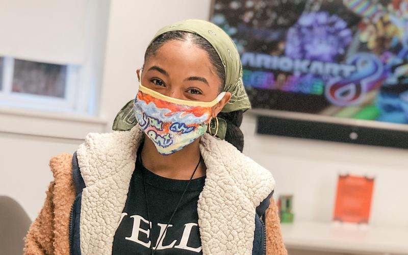 Wells student with face mask in Sommer Center game room