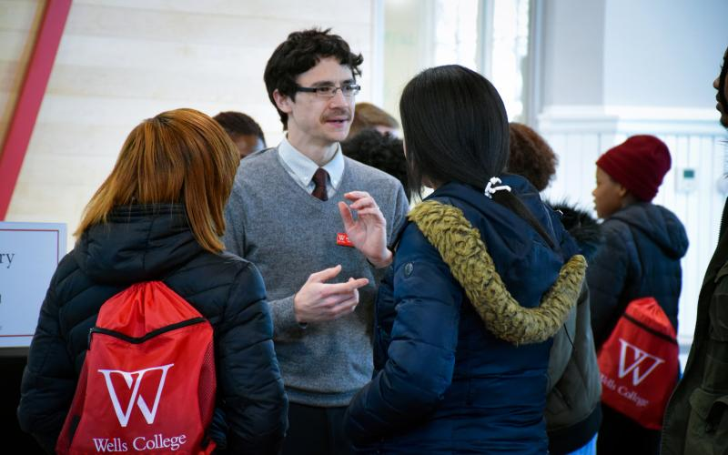 Wells College history professor speaking with newly admitted students