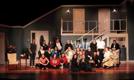 full cast and crew on stage