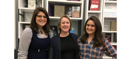 ana, deb, and jes standing in front of a bookcase