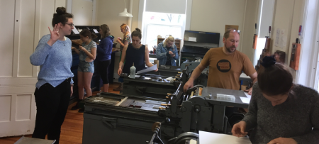 students working in the book arts center