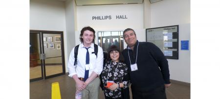 student and faculty at conference