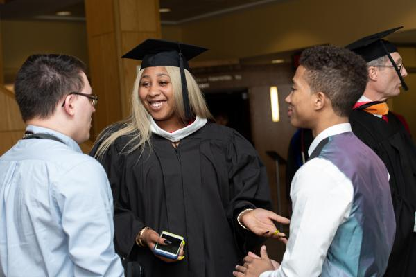 Graduate speaking with others