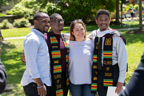 Graduates pose for picture with friends/family