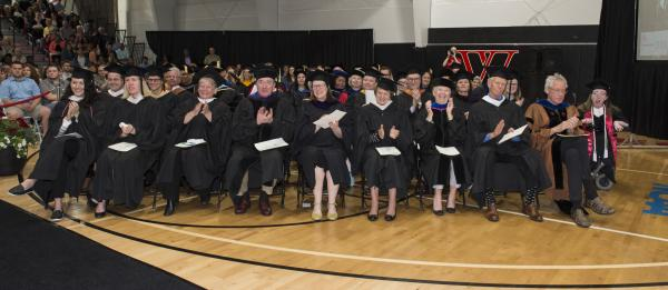 Trustees and faculty watch the ceremony