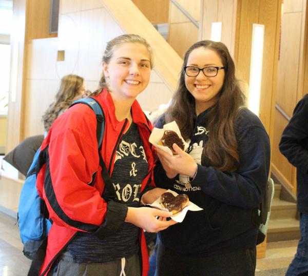 photo of students holding heart shaped donuts