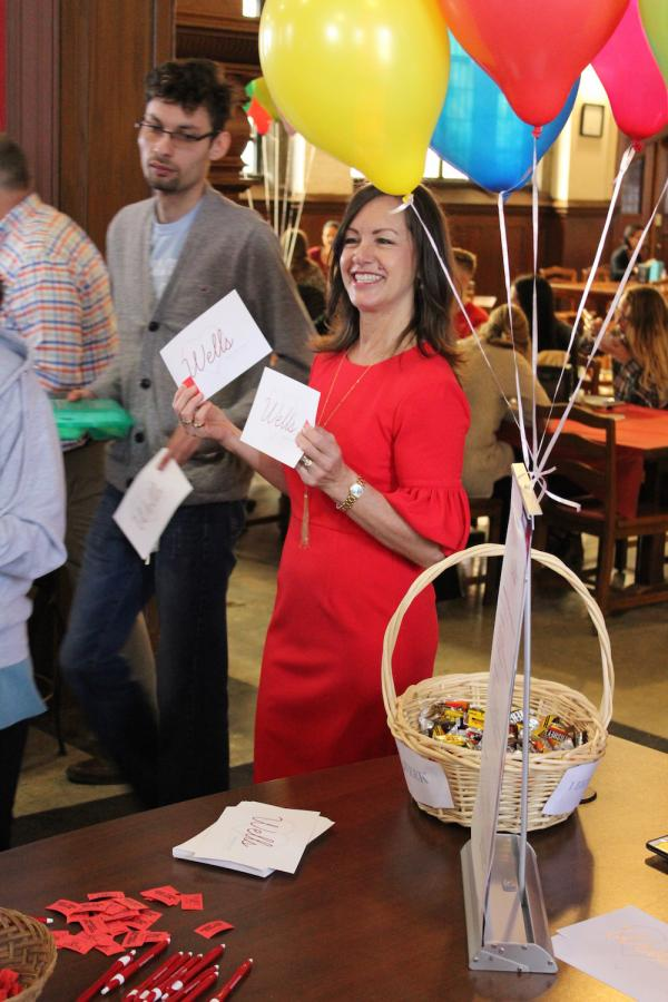 photo of kelly brown with cards and balloons