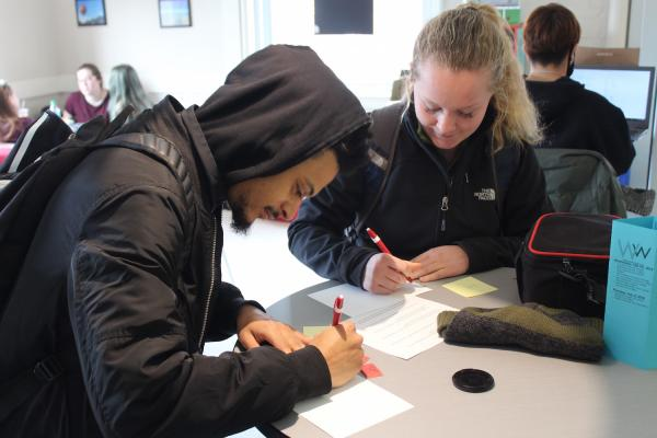photo of students writing thank you cards in the grind