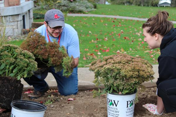 Alumni working on Pettibone lanscaping project