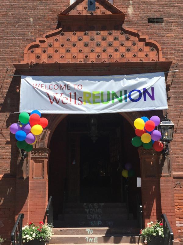 main building doorway with welcome to reunion sign