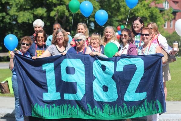 class of 1982 with banner