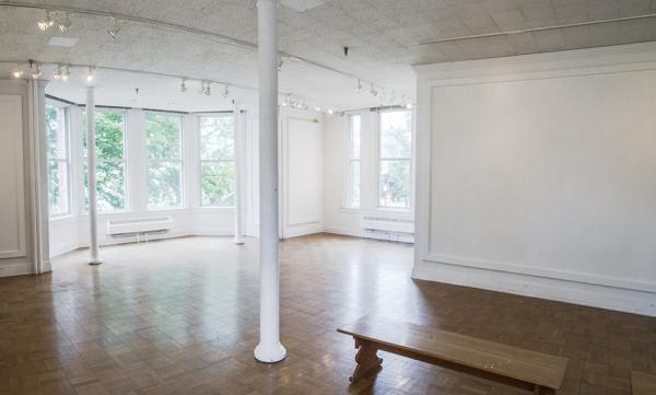 empty gallery space front windows