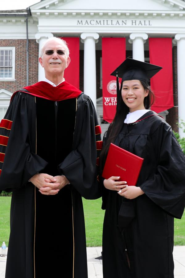 President Gibralter stands with Ailin Dolson-Fazio '21