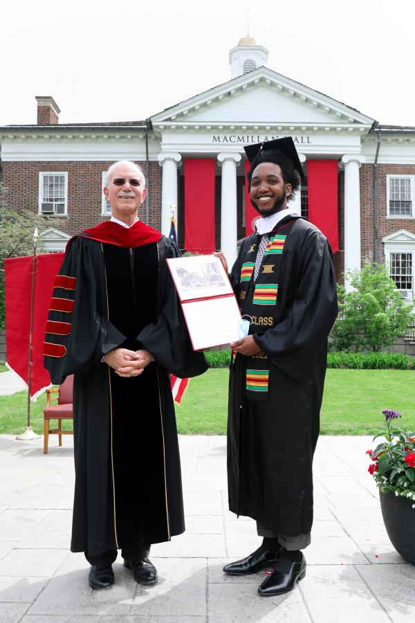 President Gibralter stands with Amari Kelly '21